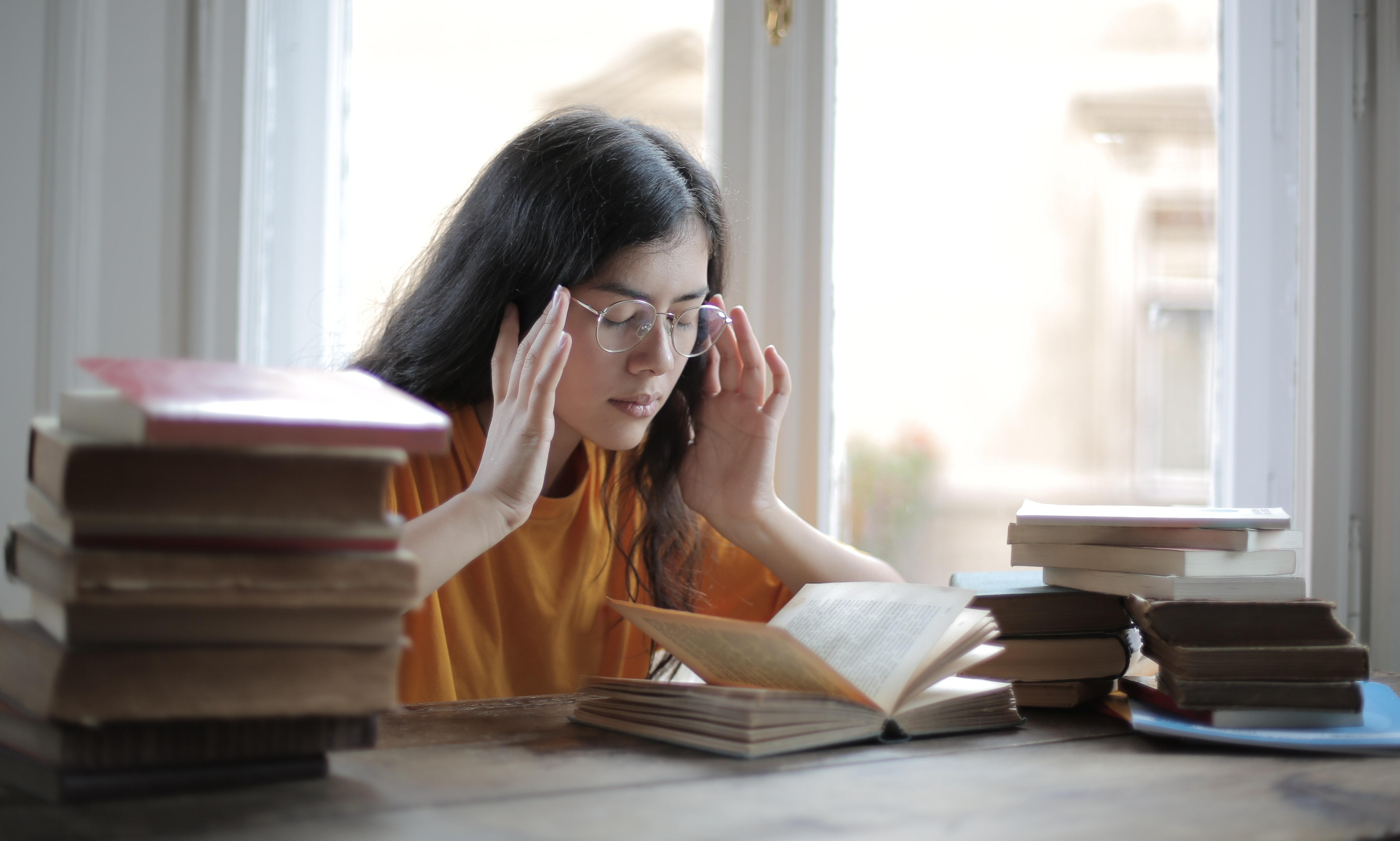 Girl feeling stressed over H2 Chemistry lessons